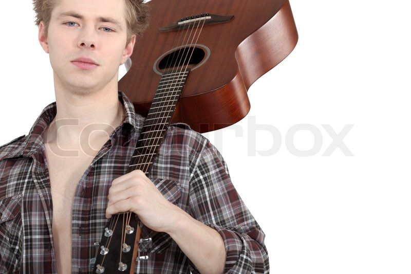 8742631-man-carrying-acoustic-guitar.jpg