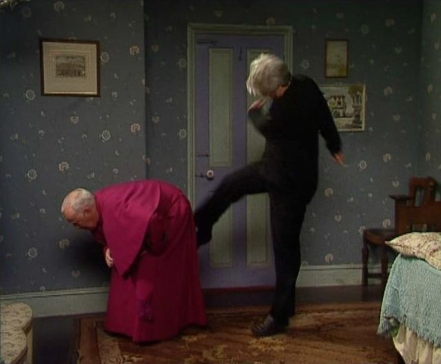 Ted_kicks_Bishop_Brennan.jpg
