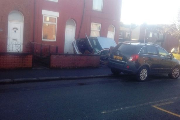 The-car-on-its-side-in-a-front-garden-in-Fairfield-Road.jpg