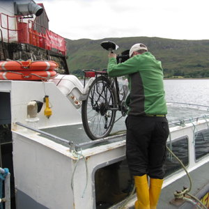 Fort William to Camusnagaul ferry - loading the bike