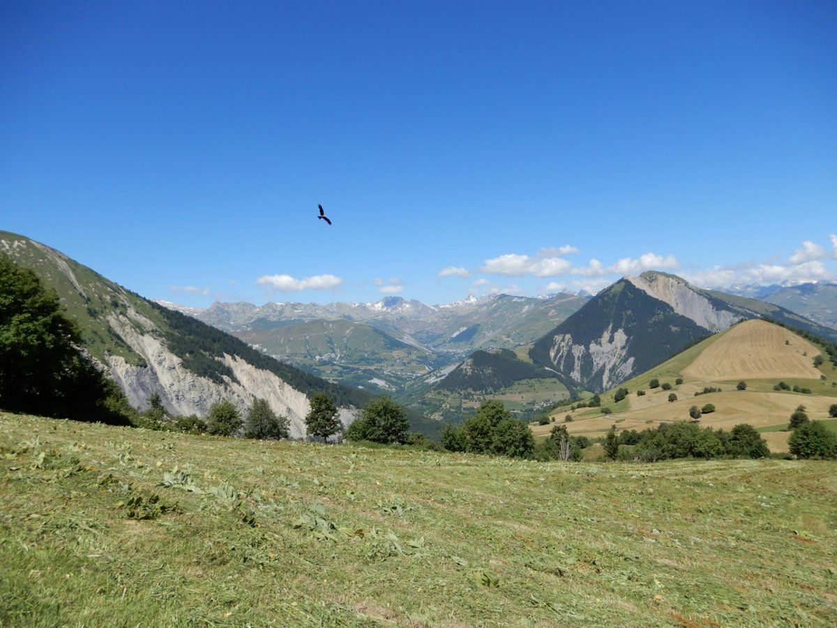 View northwest towards the climb up to Col de la Croix de Fer from the road above and south of Chalmieu